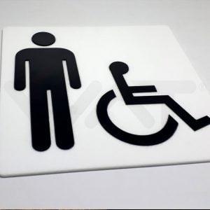 foto de placa quadrada branca com símbolo da deficiência física e ícone de um homem, ambos pretos
